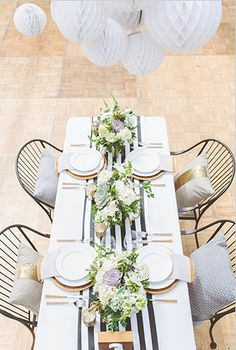 Black and white tablescape with white balloons.