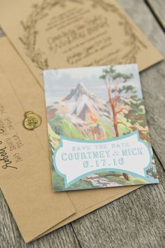 lyons farmette; lucky malone photography; outdoor wedding; outdoor ceremony; outdoor reception; tented reception; farm wedding; kraft paper stationery; mountain scene save the date; painted save the date