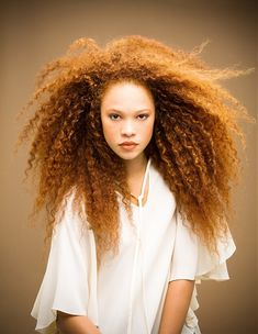 beautiful model, frizzy kinky curly gorgeous long delicious hair. Portrait.