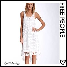 """This amazing white crochet - Lace dress by Free People is absolutely gorgeous! It features a beautiful crochet-lace design pattern, a scoop neck, racerback, & high-low style. It has a inner detachable slip that snaps to the dress. Lace: 95% cotton & 5% rayon; Slip: 55% linen & 45% cotton. It's about 42"""" at its shortest point & 46"""" long. Will best fit sizes 10-12. This is a truly beautiful & well made dress! """