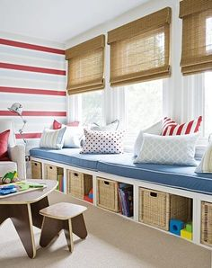 Playroom toy storage and seating under windows