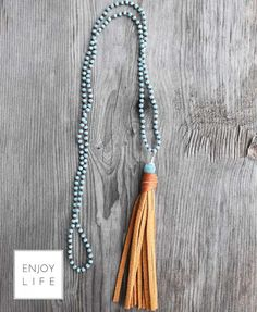 Boho chic diffuser necklace with turquoise beads and tan leather tassel. You can diffuse your essential oils in this necklace.