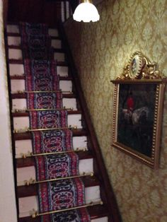 Dollhouse third floor staircase after restoration.