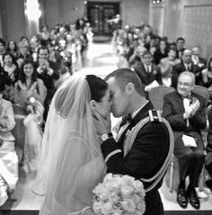 Every first kiss picture has the priest in it. This one has the family, it's different & such a good idea. So cute!