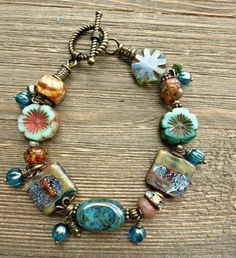 Glitter. Lampwork glass, Czech glass, bronze metal jewelry set. Necklace, earrings, bracelet.