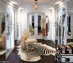 Amazing: Her enviable closet is decked out with a chandelier and cowhide rug and larger than many Manhattan studio apartments.