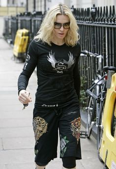 Madonna | 43 Celebrities Who Swear By Yoga | Loved and pinned by www.downdogboutique.com