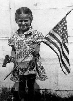 Gun, girl & flag
