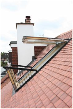 Simply Loft London loft conversion VELUX CABRIO balcony window