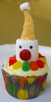 Fun for a Kid's Birthday Party...how to make the marshmallow clown for a clown cupcake.  Too cute!