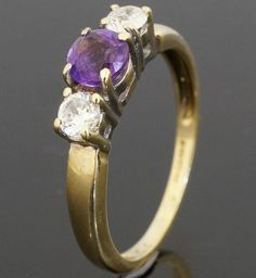 9carat Yellow Gold Amethyst & Diamond Three Stone Ring (Size O)  https://www.jollysjewellers.com/product/9carat-yellow-gold-amethyst-diamond-three-stone-ring-size-o/