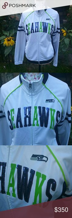 Seahawks Rare Sold Out Nike NFL Fleece Jacket Women's medium but fits a small best New condition  Gorgeous Sold out no longer available at Nike NFL Price based on rarity Women's Size Medium Seattle Seahawks fleece lined jacket/ zip up sweatshirt Fits a Small better than a medium in my opinion  Nike NFL brand Lightweight w/ soft fleece Very pretty bright colors with fun Victoria's Secret Pink bling style sequines on front!! Love this and haven't worn yet but am thinking of keeping it. Free…