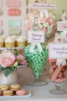 All Set partnered with Sibby's Cupcakery to create different fun themed dessert displays, including this pretty in pink dessert display using light pastel colored candy and cupcakes!