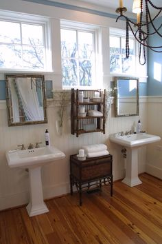 LOVE the windows, wainscoting and floors but not the tiny mirrors and lack of storage.