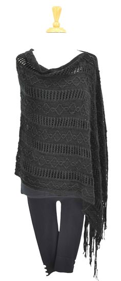 Black long woven knitted poncho. This long poncho is warm, comfortable & looks stylish!    - Boat neck  - Knitted pattern  - Free size - 8 to 20  - Uneven hem  - Fabric is acrylic  - Other colours available as well    Tassel end is 103 cm & shorter end is 65 cm