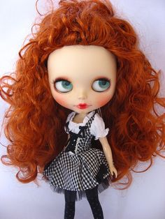 The doll is straight up creepy, but I love her hair colour.