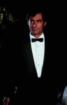"James Bond, played here by Timothy Dalton, arrives at a casino in tuxedoed, high-Bond style, and a collection of the character's garb is a major part of the exhibition: ""[Bond] himself has been fairly consistent in his sophisticated tailored suits, with the exception of maybe Roger Moore, who was a bit more trendy,"" says Hemming. ""Generally, it's very classic."""