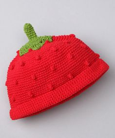 Little ones can get away with a lot, like wearing a bright strawberry on their heads. Pepped up in red, this hand-crocheted hat goes the extra mile when it comes to darling details. From the teeny stem to the soft hem, this sweet piece will refresh a mini wardrobe with color and uniqueness. And because of its lightweight knit, this topper is perfect for any season of the year. 100% cotton