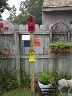 Totem Pole Birdhouses.... The top one (red) is a house with a feeder on the bottom.