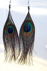DIY feather earrings, gonna have to give these a try, but with way better wire and ear hooks.  my time at the bead works has payed off...