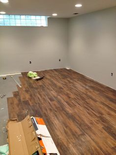 Installing peel and stick laminate floors in a basement remodel by Cozy Cape Cottage More