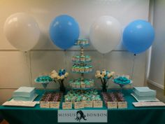 To celebrate the launch of their new product, Nu Skin requested a teal-themed dessert table.