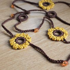 Very pretty Sunflower gold & brown crochet long flower necklaceMade with cotton, this necklace very easy to wear and will look pretty in the autumn.The necklace is very long and measures in length (just under 38 inches)Can be worn as o. Love Crochet, Bead Crochet, Crochet Crafts, Crochet Lace, Crochet Earrings, Crochet Sunflower, Crochet Flowers, Textile Jewelry, Fabric Jewelry
