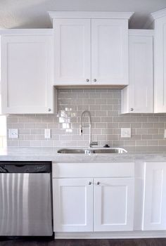 Gray subway tile and white cabinets; would always be easy to change accent colors