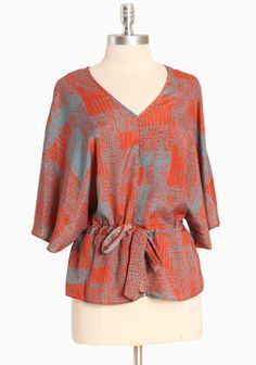 """Arbor Crest Print Top  32.99 at shopruche.com. This lightweight kimono-inspired top is accented with a subtle abstract print in a pretty orange and blue palette. Finished with dolman sleeves, an elasticized waistline with an adjustable drawstring for defining detail, and a flattering v-neckline.100% Polyester, Imported, 25"""" length from top of shoulder"""