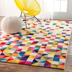 Looking to add a bit of color to your home? Then look no further than this cheery triangle mosaic rug. This machine made area rug is made of 100-percent polypropylene which makes it easy to clean and
