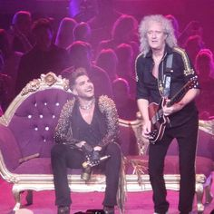 @broncook76  ·  Aug 30 Lots of love for this shot of @ adamlambert admiring the genius that is @DrBrianMay. @QueenWillRock \m/