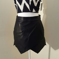 Faux leather mini skirt EUC Faux leather mini skirt with sexy asymmetrical cut in front. 2 pockets, zipper in back. Satin lined. Small. 28 waist,  14 length. Excellent used condition. Forever 21 Skirts Mini