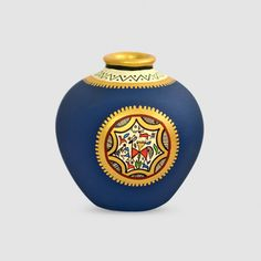 A beautifully handcrafted terracotta vase in unique matki shape, hand painted in a lovely blue with a patch of warli art in contrasting colours of gold and red. Beautiful hand painting has been done around the neck of matki which is coloured gold. Worli Painting, Bottle Painting, Bottle Art, Ganesha Painting, Madhubani Painting, Bottle Crafts, Abstract Paintings, Pottery Painting Designs, Pottery Designs
