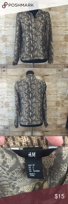 Snakeskin patterned button down top Half button down, light wear no stains or tears this is a size 4 so I am listing as a size small (my dress form is a size medium) offers are always welcome in my closet, bundle 2 or more items and receive 15% off your total purchase  H&M Tops