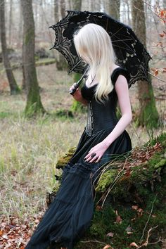 Pensive #Goth girl with parasol. Lovely corset and ring.