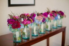 Fuchsia and peacock feather bouquets designed by Fleur Inc