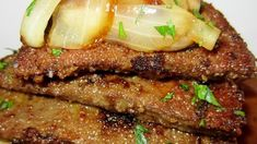 Tender calf's liver is simmered with sweet onion in a rich gravy in this traditional dish.