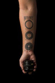 Fancy - Camera lens instruction tattoo.nl