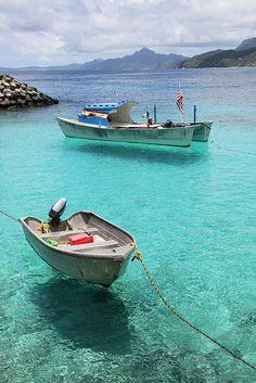 Boats floating over Aunu'u's Crystal Clear Harbor - American Samoa