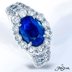 2247-030 - Platinum sapphire and diamond ring featuring a 2.90ct oval blue sapphire encircled with round diamonds