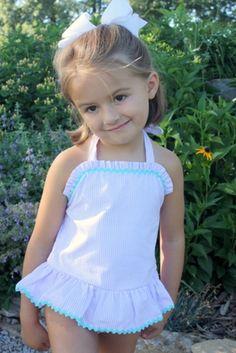 A classic seersucker stripe one-piece swim suit for your little girl!