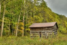 The Homestead. Old log cabin tucked away on the top of a mountains in West Virginia.