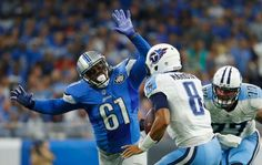 Detroit Lions defensive end Kerry Hyder (61) chases Tennessee Titans quarterback Marcus Mariota (8) during the first half of an NFL football game, Sunday, Sept. 18, 2016, in Detroit.