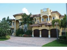 """Cocoa Beach Mediterranean Home  Mediterranean Stucco Home With Clay Tile Roof    6679 Total Square Feet  1st Floor 3539  2nd Floor 3140  Width: 80'-0"""" Depth: 65'-0""""  5 Bedrooms  6 Full Baths, 1 Half Bath  3-Car Garage  3-Car Attached, Front Entry  Size: 27'-8"""" x 20'-0""""  Standard Foundation - Slab  Exterior wall framing - Concrete block"""