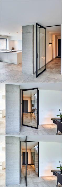 "Modern glass pivot door, custom-made by Anyway Doors. This unique ""steel look"" pivoting door with offset axis pivot hinges doesn't require any parts to be built-in to the floor. #pivotdoor #anywaydoors"