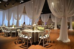 The panels drape open for the reception which creates a fun entrance into the center areas where the dance floor and the head table. It also add such elegant dimension to the room! #ceremony #transformation #wedding #draping #elegant #sheer #reception ~Draping by Events Plus Nashville