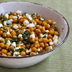Garlicky Roasted Chickpeas (Garbanzo Beans) with Feta, Mint, and Lemon  2 cans (15 oz. can) chickpeas (also called garbanzo beans), rinsed and drained 2 T olive oil (recipe called for 3 T which I thought was too much) 2 fresh garlic cloves, finely minced (I would not use garlic from a jar for this recipe) 1/8 tsp. red pepper flakes salt and fresh ground black pepper to taste 3/4 - 1 cup crumbled Feta (recipe cal