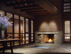 sunken hot tub by fireplace