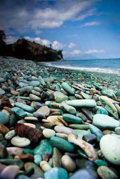Penggajawa Beach (Green-blue Stone Beach), Ende, Nusa Tenggara Timur. It is a beautiful, volcanic black sand beach covered in blue pebbles and stones.