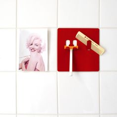 Razor By Sibylle Pfeiffer This piece is a stylish ornament for your bathroom wall with convenient hooks for your razor. It's a delightful combination of form and function.